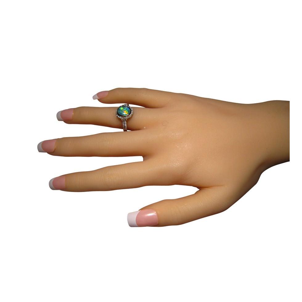 Elegant opal and multi diamond ring