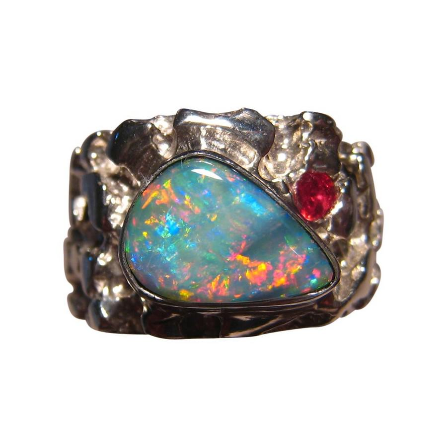 Custom opal ring in silver with one ruby